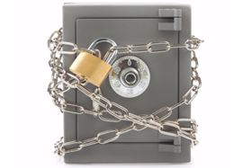 A Safe Chained Up With A Chain And Padlock