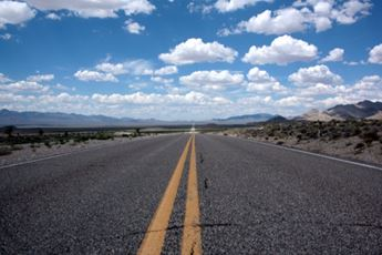 A Road showing the sky and horizon in the distance