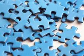 Blue Puzzle Pieces Scattered On Top Of Each Other