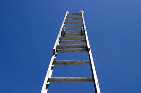 An Extended Ladder Pointing At The Sky