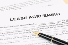 A Lease Agreement Contract with A Pen On Top